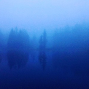Fog over an alpine lake